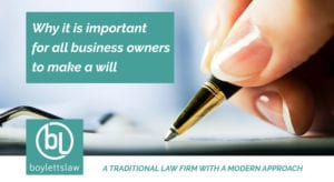Woman's hand signing a document image for why business owners should make a will blog