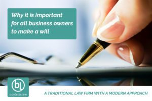 Woman holding a pen signing a document image for why business owners should make a will blog