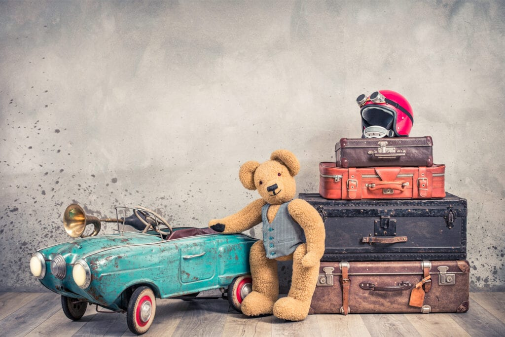 Teddy bear with luggage and a car image for 5 reasons parents should make a will